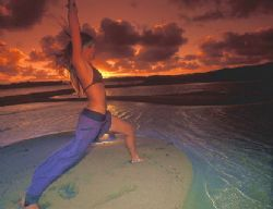 yoga on the beach at Sodwana Bay South Africa. a sunset a... by Fiona Ayerst