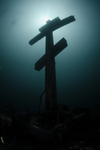 The cross is set on the underwater pinnacle in Lake Baykal. by Dmitry Starostenkov