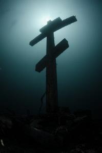 The cross is set on the underwater pinnacle in Lake Baykal. by Dmitry Starostenkov