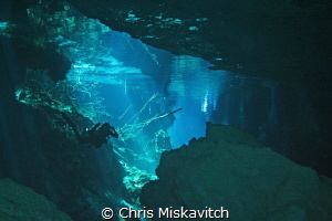 Cenote and Diver by Chris Miskavitch