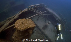 Sitting at a depth of 150-feet, a diver explores the ster... by Michael Grebler