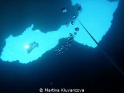 Freediver entering Cave Lučice GPS: N 43 18 12, E 16 27 1... by Martina Kluvancova