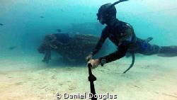 Freediving wreck @ Mabul Island, Malaysia by Daniel Douglas