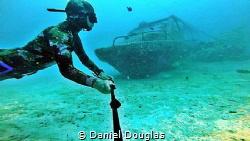 Speedboat wreck in Mabul Island, Malaysia by Daniel Douglas
