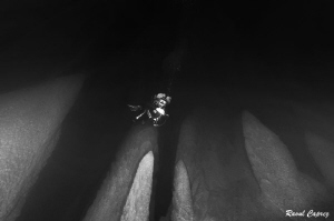 Diving between the stalagmits by Raoul Caprez