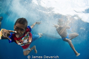 Kid's of Alor / Super friendly village came to greet the ... by James Deverich