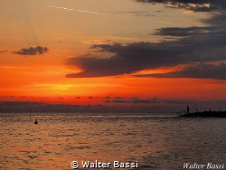 The sea and the fisherman by Walter Bassi