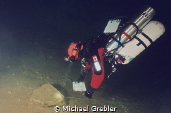 Side-mount diver mapping out the tunnel system of a flood... by Michael Grebler