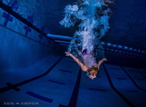 Diver from a high school comes in from a 3m diving board by Ken Kiefer