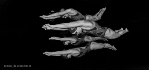 Swimmers streamlining like dolphins by Ken Kiefer