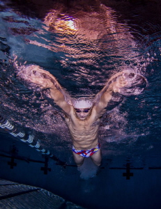 Elite College Swimmer performing butterfly by Ken Kiefer