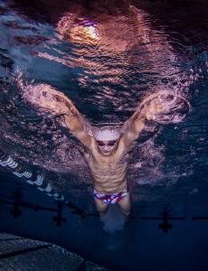 Elite College Swimmer performing butterfly by Ken Kiefer