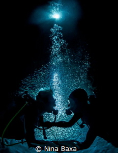 Honeymooners - a couple on a dive with Silversides a day ... by Nina Baxa