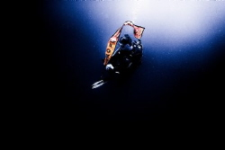 Diver preparing an inflatable beacon during stormy (low v... by Zaid Al Sager