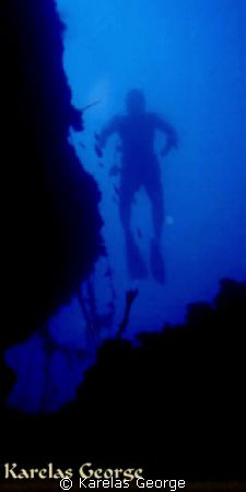 Diver's silhouette at the vertical rocks