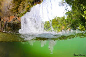Behind the water falls by Raoul Caprez