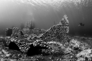 An ancient submerged mill by Pietro Cremone