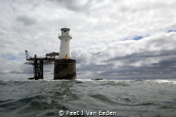 Diver's view of a lighthouse by Peet J Van Eeden