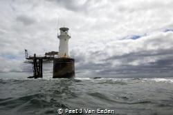 Diver's view of a lighthouse by Peet J Van Eeden
