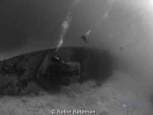 We were diving the wreck of the Tibbetts for a photo cour... by Robin Bateman