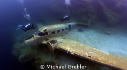 Two divers reach the airplane sunk in Morrison's Quarry. ... by Michael Grebler