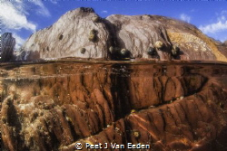 The rock pool by Peet J Van Eeden