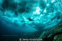 Frozen Surface - in Tobermory Ontario/Canada by Jerzy Kowalczuk