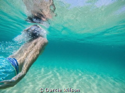 This photo is taken of my boyfriend diving under a wave. ... by Darcie Wilson