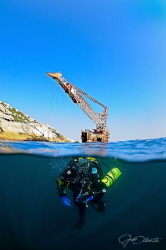 ~ Helping Hand ~ Diver descending on the wreck of the Bo... by Geo Cloete
