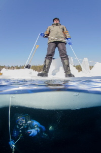 The diver and the belayer on the same shot at the ice div... by Dmitry Starostenkov