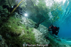 This is a occasional meeting 2 divers in Grüner See austr... by Florian Feldgrill