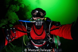 An underwater selfie of myself swimming along a wall fill... by Mazyar Jalayer