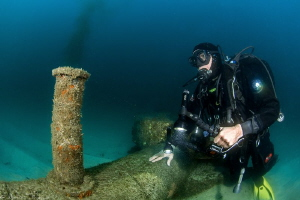 marine biologist monitoring a treatment plant outfall (Co... by Mathieu Foulquié