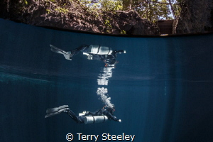 'Reflections'. The Pit Cenote, Mexico.