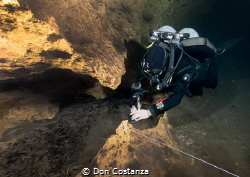 Tying wet rocks together by Don Costanza