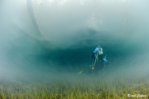 Mystic atmosphere (diving after a flood) by Raoul Caprez