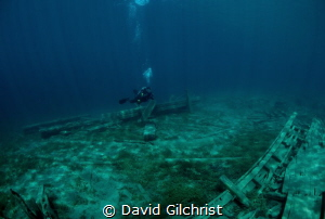 Diver/photographer explores wreckage in Little Tub Harbou... by David Gilchrist