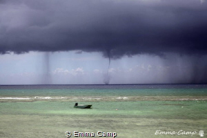 A water spout during a storm. by Emma Camp