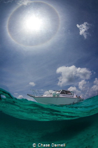 """""""Halo"""" A Sun Halo appeared above the boat while we snork... by Chase Darnell"""