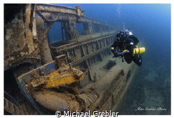 At a depth of about 70-feet, a diver pauses for a moment ... by Michael Grebler