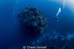 """""""The Mountain"""" A diver over looks the prestigious dive s... by Chase Darnell"""