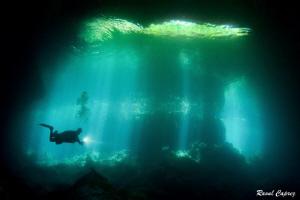 Through the light (Mexico cenote) by Raoul Caprez