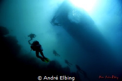 like pearls are some scuba divers diving along the riff a... by André Elbing
