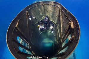 Diver in funnel of Kittiwake wreck by Leena Roy