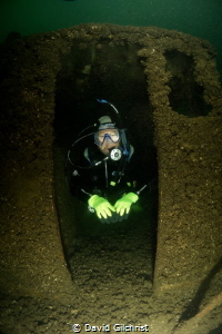 Diver emerges from boat at the Welland Scuba Park. by David Gilchrist