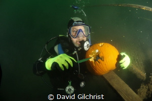 Diver works to carve a pumpkin underwater at the Welland ... by David Gilchrist