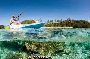 Canoe split Raja Ampat by John Parker