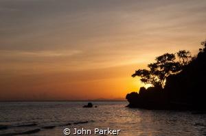 Sunset in Raja Ampat by John Parker