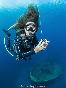 Divemaster at work by Henley Spiers