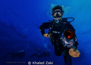 Ras Mohamed Red Sea Divers with a fish eye by Khaled Zaki